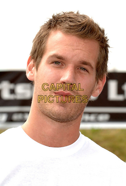 ALEX WOTHERSPOON.The Celebrity Driving Challenge, ExCeL, London, England..July 23rd, 2008.headshot portrait stubble facial hair .CAP/WIZ.© Wizard/Capital Pictures.