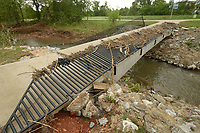 NWA Democrat-Gazette/BEN GOFF @NWABENGOFF<br /> Debris hangs on the mangled railing Monday, May 1, 2017, on a trail bridge at Mercy Trailhead in Rogers.