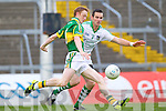 Colm Cooper launches an attack past  Mark O'Riordan in the Muster Senior Semi final held in The Gaelic Grounds last Saturday evening.