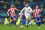 "Cristiano Ronaldo (c) of Real Madrid battles for the ball with Manuel Castellano ""Lillo"" (l) and Ismael Lopez Blanco ""Isma"" of Real Sporting de Gijon during the La Liga match between Real Madrid and Real Sporting de Gijon at the Santiago Bernabeu Stadium on 26 November 2016 in Madrid, Spain. Photo by Diego Gonzalez Souto / Power Sport Images"