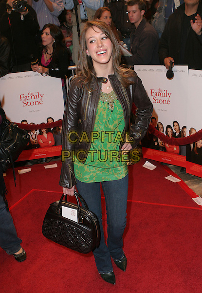 """HAYLIE DUFF.""""The Family Stone"""" Premiere - Arrivals held at Mann Village Theater, Westwood, California..December 6th, 2005.Photo: Zach Lipp/AdMedia/Capital Pictures.Ref: ZL/ADM.full length green top brown leather jacket bag purse jeans denim.www.capitalpictures.com.sales@capitalpictures.com.© Capital Pictures."""