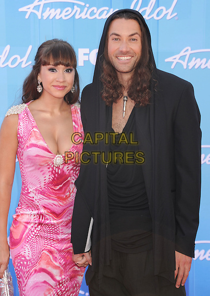 Diana DeGarmo, Ace Young.American Idol Season 11 Finale - Arrivals held at Nokia Theatre LA Live, Los Angeles, California, USA..May 23rd, 2012.half length pink white print dress black suit hood cleavage .CAP/ROT/TM.©Tony Michaels/Roth Stock/Capital Pictures