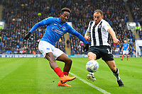 Jamal Lowe of Portsmouth crosses the ball under pressure from Barry Fuller of Gillingham during Portsmouth vs Gillingham, Sky Bet EFL League 1 Football at Fratton Park on 6th October 2018