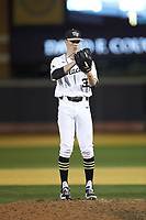 Wake Forest Demon Deacons relief pitcher William Fleming (38) looks to his catcher for the sign against the North Carolina State Wolfpack at David F. Couch Ballpark on April 18, 2019 in  Winston-Salem, North Carolina. The Demon Deacons defeated the Wolfpack 7-3. (Brian Westerholt/Four Seam Images)