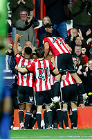 GOAL - Ryan Woods of Brentford is mobbed after his goal during the Sky Bet Championship match between Brentford and Leeds United at Griffin Park, London, England on 4 November 2017. Photo by Carlton Myrie.