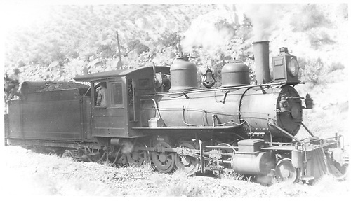 Engineer's-side view of D&amp;RG #220 taking water at Embudo.<br /> D&amp;RG  Embudo, NM  Taken by Perry, Otto C. - 10/20/1920