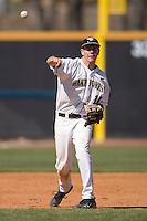 Shortstop Shane Kroker #10 of the Wake Forest Demon Deacons makes a throw to first base versus the Virginia Cavaliers at Wake Forest Baseball Park March 8, 2009 in Winston-Salem, NC. (Photo by Brian Westerholt / Four Seam Images)