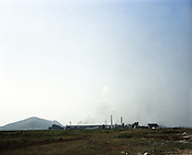 A steel plant is seen in the distance in Kalinga Nagar industrial area in Orissa, India.