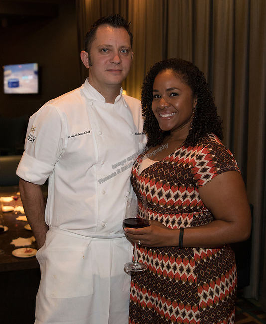 Chef Michael Mahoney and his fiancee Estrella Coulter during a cooking demonstration inside Charlie Palmer Lounge in the Grand Sierra Resort on Thursday night, October 12, 2017.