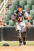 Hickory Crawdads catcher Jorge Alfaro #11 checks the runner after picking up a wild pitch during the game against the Kannapolis Intimidators at CMC-Northeast Stadium on April 8, 2012 in Kannapolis, North Carolina.  The Intimidators defeated the Crawdads 12-11.  (Brian Westerholt/Four Seam Images)