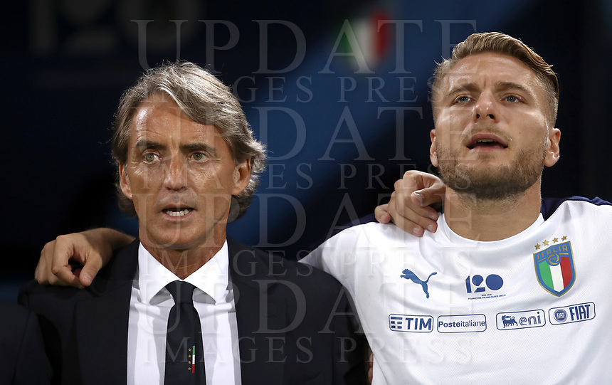 Football: Uefa Nations League match Italy vs Poland, Renato Dall'Ara stadium, Bologna, Italy, September 7, 2018. <br /> Italy's national team coach Roberto Mancini (l) and Italy's Ciro Immobile (r) sing the Italy national anthem prior to the Uefa Nations League match between Italy and Poland at the Renato Dall'Ara stadium, Bologna, Italy, September 7, 2018. <br /> <br /> UPDATE IMAGES PRESS/Isabella Bonotto