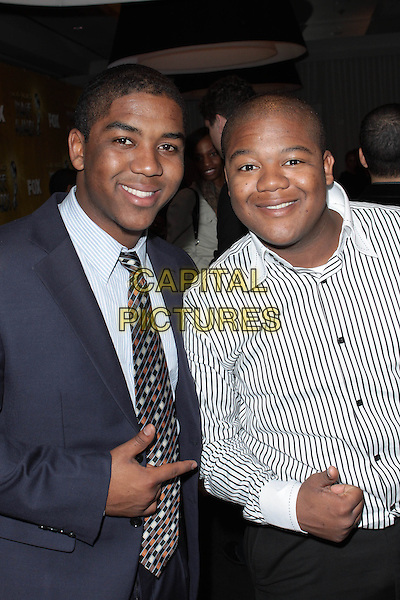 CHRIS MASSEY & KYLE MASSEY.41st Annual NAACP AWARDS Nomination Announcements and Press Conference  held at  The SLS Hotel, Beverly Hills, California, USA,.6th January 2010..half length family brothers white striped shirt black blue suit jacket finger hand gesture tie smiling .CAP/ADM/TC.©T.Conrad/Admedia/Capital Pictures