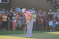 Rory McIlroy (NIR) watches his father Gerry McIlroy and Girlfriend Caroline Wozniacki on the side of the 18th green on the third day of the DUBAI WORLD CHAMPIONSHIP presented by DP World, Jumeirah Golf Estates, Dubai, United Arab Emirates.Picture Fran Caffrey www.golffile.ie