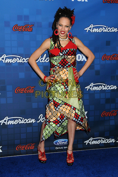 """NAIMA ADEDAPO.Fox's """"American Idol"""" Season 10 Finalist Party held at The Grove, Los Angeles, California, USA..March 3rd, 2011.full length hands on hips green red black yellow print sleeveless dress flower in hair .CAP/ADM/BP.©Byron Purvis/AdMedia/Capital Pictures."""