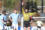 14 November 2010: Referee Landis Wiley shows the red card to UNC's Michael Farfan (left). The University of Maryland Terrapins defeated the University of North Carolina Tar Heels 1-0 at WakeMed Soccer Park in Cary, North Carolina in the ACC Men's Soccer Tournament Championship game.