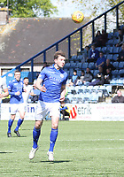 Darren Brownlie heading the ballin the SPFL Ladbrokes Championship Play Off semi final match between Queen of the South and Montrose at Palmerston Park, Dumfries on  11.5.19.