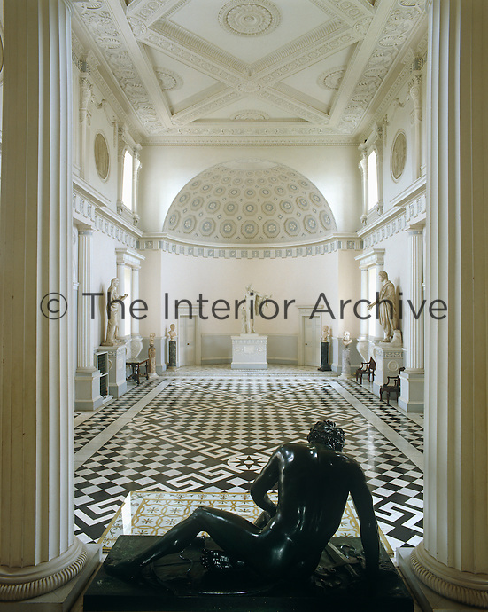 The bronze of The Dying Gaul by Valodier faces Apollo in the apse down The Great Hall at Syon House designed by Robert Adam