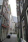 Street leading to Oude Kerk, (old church), Amsterdam, Netherlands,