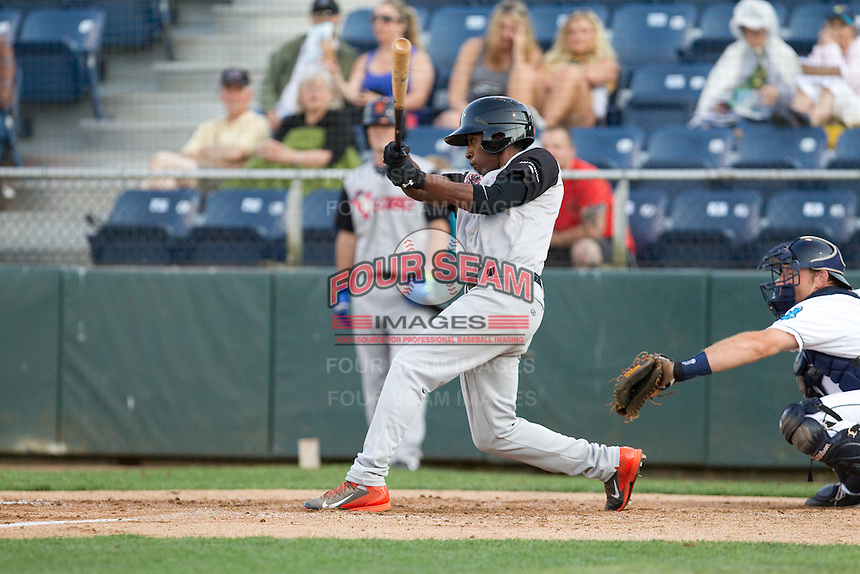 Travious Relaford #6 of the Salem-Keizer Volcanoes at bat during a game against the Everett AquaSox at Everett Memorial Stadium in Everett, Washington on July 14, 2014.  Salem-Keizer defeated Everett 6-4.  (Ronnie Allen/Four Seam Images)