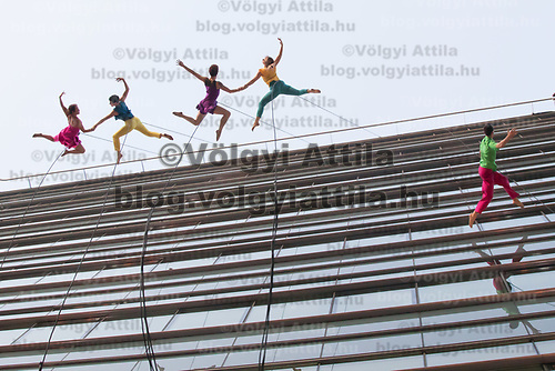 Members of the Bandaloop company from USA perform on the glass wall of an office building during the the CAFe Contemporary Art Festival in downtown Budapest, Hungary on Oct. 20, 2017. ATTILA VOLGYI