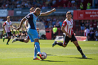 Jordan Bowery of Leyton Orient shoots at goal under pressure from James Jennings of Cheltenham during the Sky Bet League 2 match between Cheltenham Town and Leyton Orient at the LCI Rail Stadium, Cheltenham, England on 6 August 2016. Photo by Mark  Hawkins / PRiME Media Images.