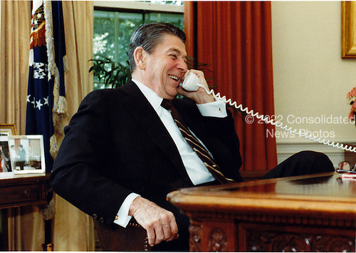 United States President Ronald Reagan telephones Prime Minister Margaret Thatcher of Great Britain from the Oval Office of the White House in Washington, D.C. on Friday, June 10, 1983 to congratulate her on the impressive victory of her party..Mandatory Credit: Billie B. Shaddix - White House via CNP