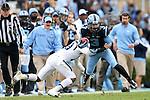 23 November 2013: UNC's Ryan Switzer (3) is tackled by ODU's Sandy Chapman (18). The University of North Carolina Tar Heels played the Old Dominion University Monarchs at Keenan Stadium in Chapel Hill, NC in a 2013 NCAA Division I Football game. UNC won the game 80-20.