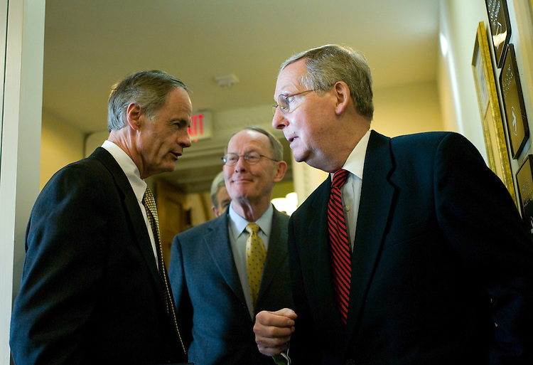 WASHINGTON, DC - Feb. 28: Sen. Thomas R. Carper, D-Del., Senate GOP Conference Chairman Lamar Alexander, R-Tenn., and Senate Minority Leader Mitch McConnell, R-Ky., talk before a news conference on the GOP housing bill alternative -- which Carper did not attend. Senate Democrats were unlikely to muster enough votes Thursday to advance a mortgage package, with Republicans expected to side with the White House and the lending industry in opposing controversial bankruptcy law changes. The Senate was expected to fall short of the 60 votes needed to invoke cloture on a motion to proceed to consideration of a bill (HR 3221) that will be the vehicle for the mortgage legislation (S 2636). (Photo by Scott J. Ferrell/Congressional Quarterly)