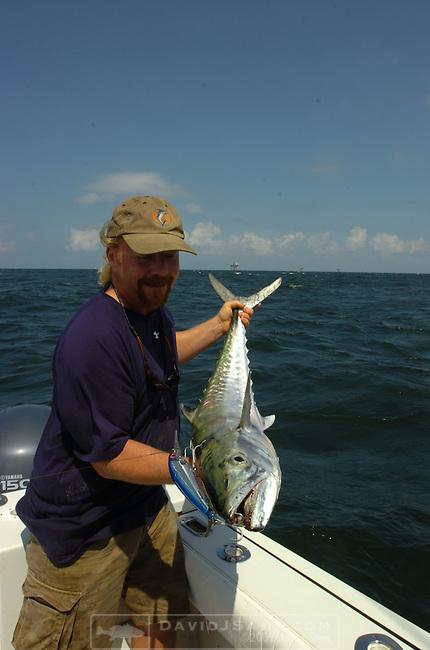 OFFSHORE FISHING.Peace Marvel shows a king mackerel caught on bomber trolling bait est. 35 pounds.near oil production platform...Venice, Louisiana