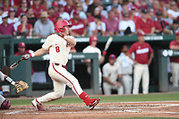 NWA Democrat-Gazette/J.T. WAMPLER Arkansas' Eric Cole connects with the ball Monday June 11, 2018 during the NCAA Super Regional at Baum Stadium in Fayetteville.