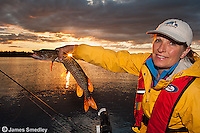 Woman angler holding a Northern pike.