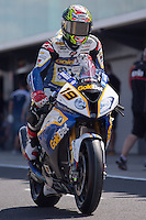 Chaz Davies (GBR) riding the BMW S1000 RR HP4 (19) of the BMW Motorrad GoldBet SBK Team leaving the pits for a practise session on day one of round one of the 2013 FIM World Superbike Championship at Phillip Island, Australia.