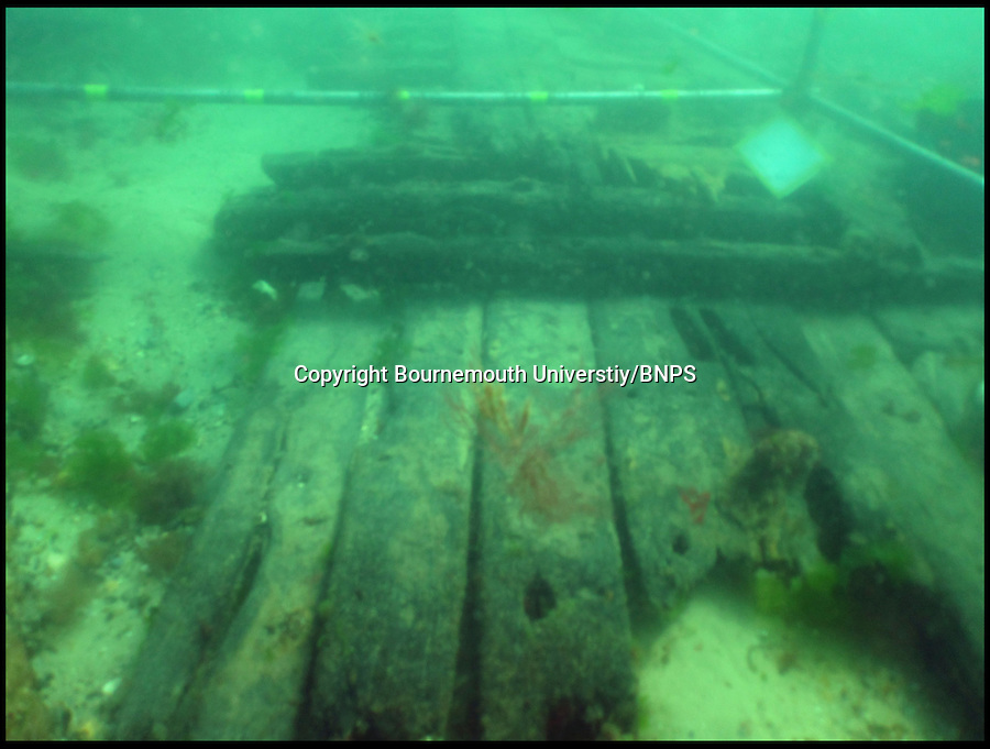 BNPS.co.uk (01202) 558833<br /> Picture: Bournemouth Universtiy<br /> <br /> **Please use byline**<br /> <br /> The wreck of the Dutch trading ship as it was discovered on the seabed near Poole, Dorset.<br /> <br /> A spectacular carving of the face of a moustachioed warrior today greeted archeologists as they raised part of a huge 17th century ship wreck in the English Channel. The intricate work of art was engraved into the 28ft long rudder section of the Dutch wooden trading ship that sunk off Poole, Dorset, in 1628. Its accidental discovery by a dredger led to six years of underwater investigations which prompted experts to hail the find as the most significant since the Mary Rose.
