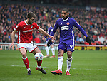 Gary Gardner of Barnsley blocks Leon Clarke of Sheffield Utd during the championship match at the Oakwell Stadium, Barnsley. Picture date 7th April 2018. Picture credit should read: Simon Bellis/Sportimage