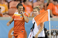 Houston, TX - Sunday August 13, 2017: Carli Lloyd grimaces after injuring a leg during a regular season National Women's Soccer League (NWSL) match between the Houston Dash and FC Kansas City at BBVA Compass Stadium.