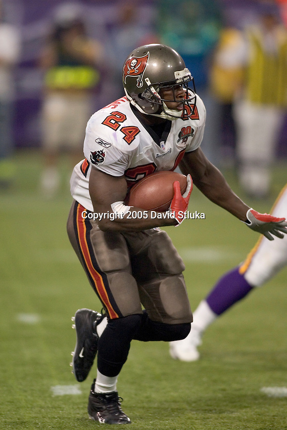 Running back Carnell Williams #24 of the Tampa Bay Buccaneers carries the ball against the Minnesota Vikings at the Metrodome on September 11, 2005 in Minneapolis, Minnesota. The Buccaneers defeated the Vikings 24-13. (Photo by David Stluka)