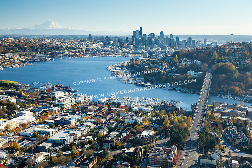 Aerial view of Seattle's Fremont and Wallingford neighborhoods, and Lake Union in the foreground with downtown skyline and Mount Rainier in the background