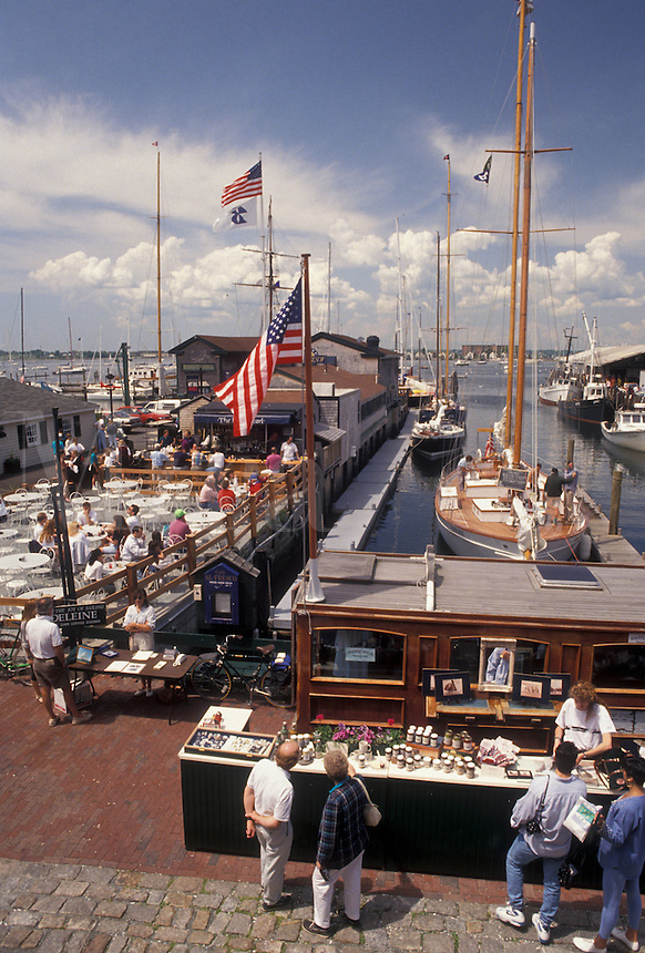 AJ4415, Newport, Newport Harbor, seaport, Rhode Island, The Mooring, People enjoying a sunny day on Sayer's Wharf in The Mooring at Newport's colonial seaport in the state of Rhode Island.