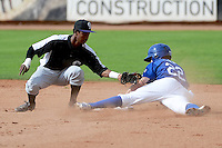 Adam Law (22) of the Ogden Raptors slides into second base against the Grand Junction Rockies while Rockies second baseman Cesar Galvez (2) makes the tag in Pioneer League play at Lindquist Field on September 8, 2013 in Ogden Utah.  (Stephen Smith/Four Seam Images)