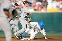 South Carolina 2B Scott Wingo completes a double play as UCLA's Beau Amaral slides into him during Game One of the NCAA Division One Men's College World Series Finals on June 28th, 2010 at Johnny Rosenblatt Stadium in Omaha, Nebraska.  (Photo by Andrew Woolley / Four Seam Images)