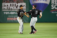 Chattanooga Lookouts left fielder LaMonte Wade (7), center fielder Tanner English (41) and right fielder Edgar Corcino (11) celebrate the final out of a game against the Jackson Generals on April 27, 2017 at The Ballpark at Jackson in Jackson, Tennessee.  Chattanooga defeated Jackson 5-4.  (Mike Janes/Four Seam Images)
