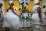 RIO DE JANEIRO, BRAZIL - JANUARY 24: Practitioners perform rituals in a candomble ceremony, in Rio de Janeiro, Brazil, on Saturday, Jan. 23, 2015. They perform specific dances which enables them to become possessed by the orixas. Brazil's Afro-Brazilian religions which in recent years have come under increasing threats and prejudice, particularly from the growing number of evangelical churches. Candombl&eacute; originated in Salvador, Bahia at the beginning of the 19th century when enslaved Africans brought their beliefs with them. Umbanda and candombl&eacute; are Afro-Brazilian religions practiced in mostly Brazil. <br /> (Lianne Milton for the Washington Post)