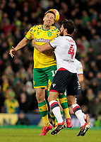 Norwich City's Marco Stiepermann heads away from Bolton Wanderers' Jason Lowe<br /> <br /> Photographer David Shipman/CameraSport<br /> <br /> The EFL Sky Bet Championship - Norwich City v Bolton Wanderers - Saturday 8th December 2018 - Carrow Road - Norwich<br /> <br /> World Copyright &copy; 2018 CameraSport. All rights reserved. 43 Linden Ave. Countesthorpe. Leicester. England. LE8 5PG - Tel: +44 (0) 116 277 4147 - admin@camerasport.com - www.camerasport.com