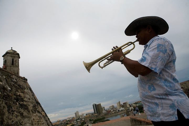 CARTAGENA, COLOMBIA - AUGUST:  A man plays his trumpet for tourists at the Castillo San Felipe fortress in Cartagena, Colombia in August 2007.  (Photo by Dennis Drenner/Aurora)..