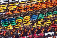 """KFZ Logistik in Bremerhaven  High & Heavy-Gueter: EUROPA, DEUTSCHLAND,BREMEN,  BREMERHAVEN  (EUROPE, GERMANY), 14.01.2012: Die aus der 1877 gegruendeten Bremer Lagerhaus Gesellschaft AG entstandene BLG Logistics Group ist heute mit 6.800 Mitarbeitern der europaeische Branchenfuehrer in der Kfz-Logistik. Das Autoterminal der BLG verfuegt ueber eine Gesamtflaeche von drei Millionen Quadratmetern und hat Platz für 120.000 Fahrzeuge. Der Gesamtwert der Fahrzeuge belaeuft sich bei voller Auslastung auf ca. 3,6 Milliarden Euro. Mit einem Gesamtumschlag von ueber zwei Millionen Fahrzeugen 2007  ist Bremerhaven der fuehrende Auto-Umschlagplatz in Europa. Die meisten der für den deutschen Markt bestimmten Import-Fahrzeuge gelangen ueber Bremerhaven nach Deutschland..Neben den Automobilen werden rund eine Million Tonnen sogenannter High & Heavy-Gueter sowie Stueckgueter und Schwergueter bis 200 Tonnen Gewicht im Ro/Ro-Umschlag bewegt. Bei den """"High & Heavy""""-Guetern handelt es sich um Baumaschinen, Bagger, Kettenfahrzeuge, Autokrane, landwirtschaftliche Geraete, Traktoren, Maehdrescher und andere Erntemaschinen, Lkw, Zugmaschinen und auch Lokomotiven. Der ICE-Testzug für Amtrak in den USA sowie der nach China gelieferte Transrapid wurden ueber Bremerhaven verschifft..Luftbilder, Luftfoto, Luftfotos, Luftphoto, Luftphotos, menschenleer, Motors, Neuwagen, Neuwagenparkplatz, niemand, oben, PKW, PKWs, Parkhaus, Parkpalette, Tag, Tage, Tageslicht, tagsueber, tagsueber, Vogelperspektive, Vogelperspektiven, von, Wagen,"""