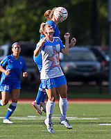 Boston Breakers forward Katie Schoepfer (2) and Chicago Red Stars midfielder Jen Buczkowski (4) compete for the high ball.  The Boston Breakers beat the Chicago Red Stars 1-0 at Dilboy Stadium.