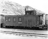 D&amp;RGW long caboose #0505 in Durango.<br /> D&amp;RGW  Durango, CO  Taken by Payne, Andy M. - 12/14/1968