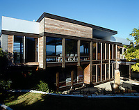 The back of the house has been landscaped into the hillside and its wooden cladding will weather over time