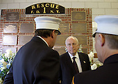 Commemorating the two-year anniversary of the terrorist attacks, Vice President Dick Cheney visits the firehouse of FDNY Rescue Company 1in New York, New York, September 11, 2003.Pictured inthe background is a memorial to the station's firefighters who have died in the line of duty,includingthe company'seleven firefighterswho lost their lives September 11, 2001.<br /> Mandatory Credit: David Bohrer / WH via CNP
