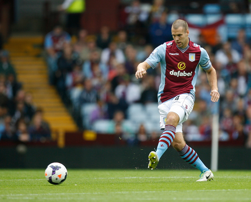 Aston Villa's Ron Vlaar in action during todays match  <br /> <br /> Photo by Jack Phillips/CameraSport<br /> <br /> Football - Barclays Premiership - Aston Villa v Manchester City - Saturday 28th September 2013 - Villa Park - Birmingham<br /> <br /> &copy; CameraSport - 43 Linden Ave. Countesthorpe. Leicester. England. LE8 5PG - Tel: +44 (0) 116 277 4147 - admin@camerasport.com - www.camerasport.com